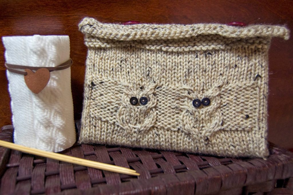 Knitted book cover with owls