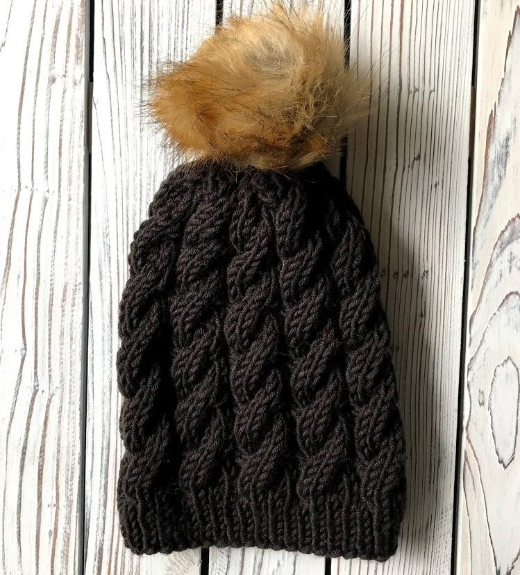 Black hat with faux fur pom pom