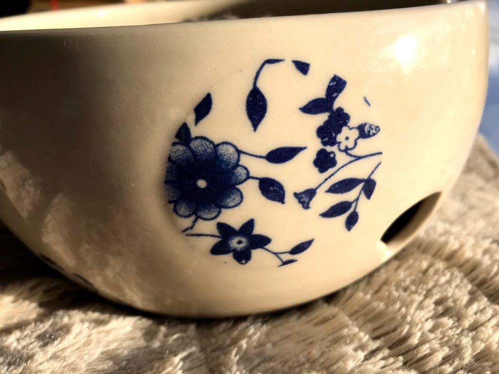 close up of flowers on yarn bowl